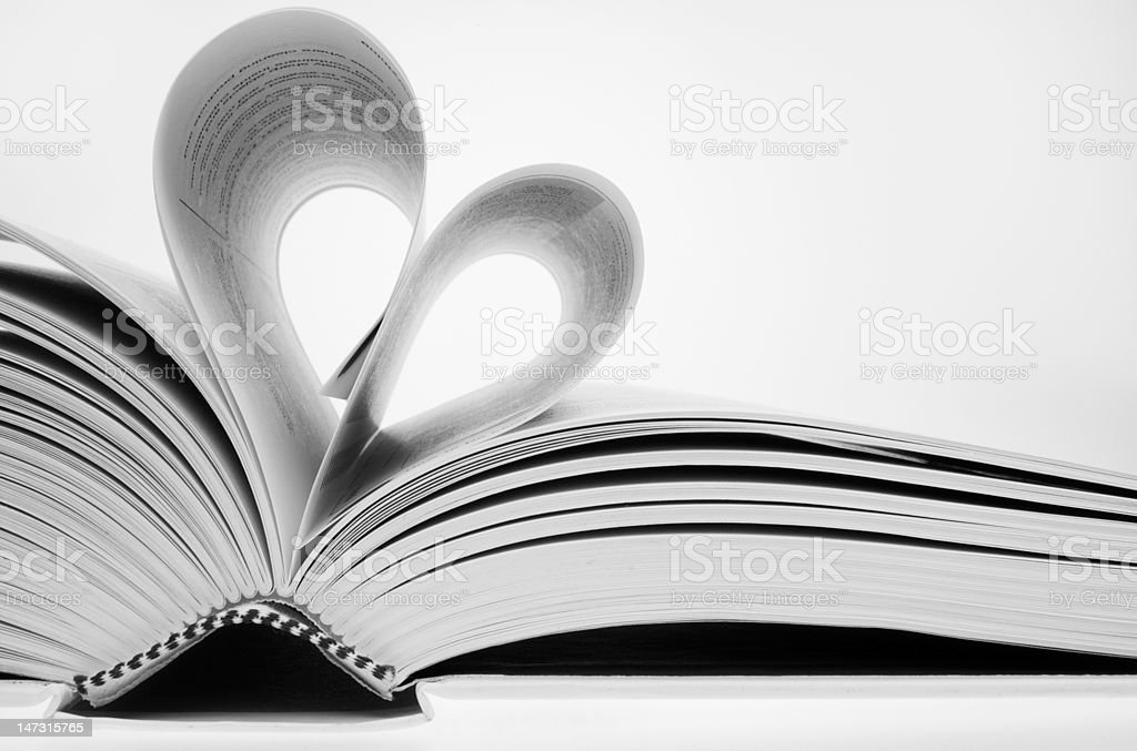 opened book with pages folded in a heart shape royalty-free stock photo