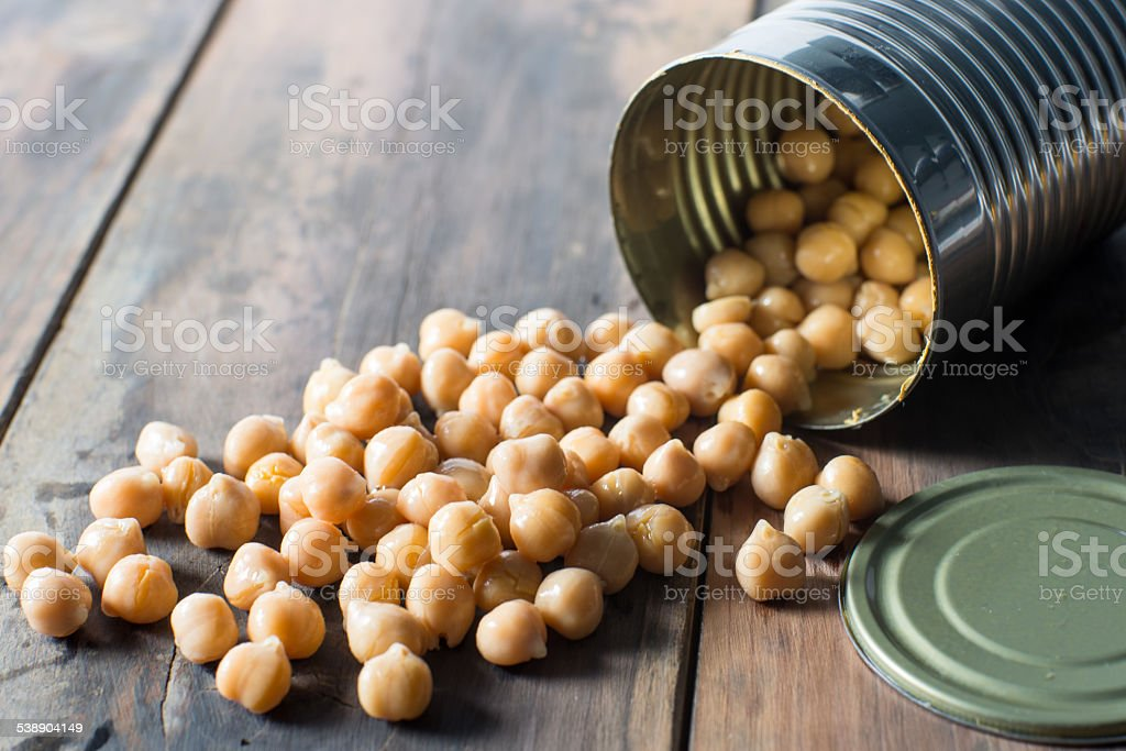 opened can of garbanzo chick peas stock photo