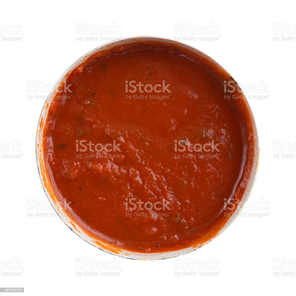 Opened can of spaghetti sauce on a white background. stock photo