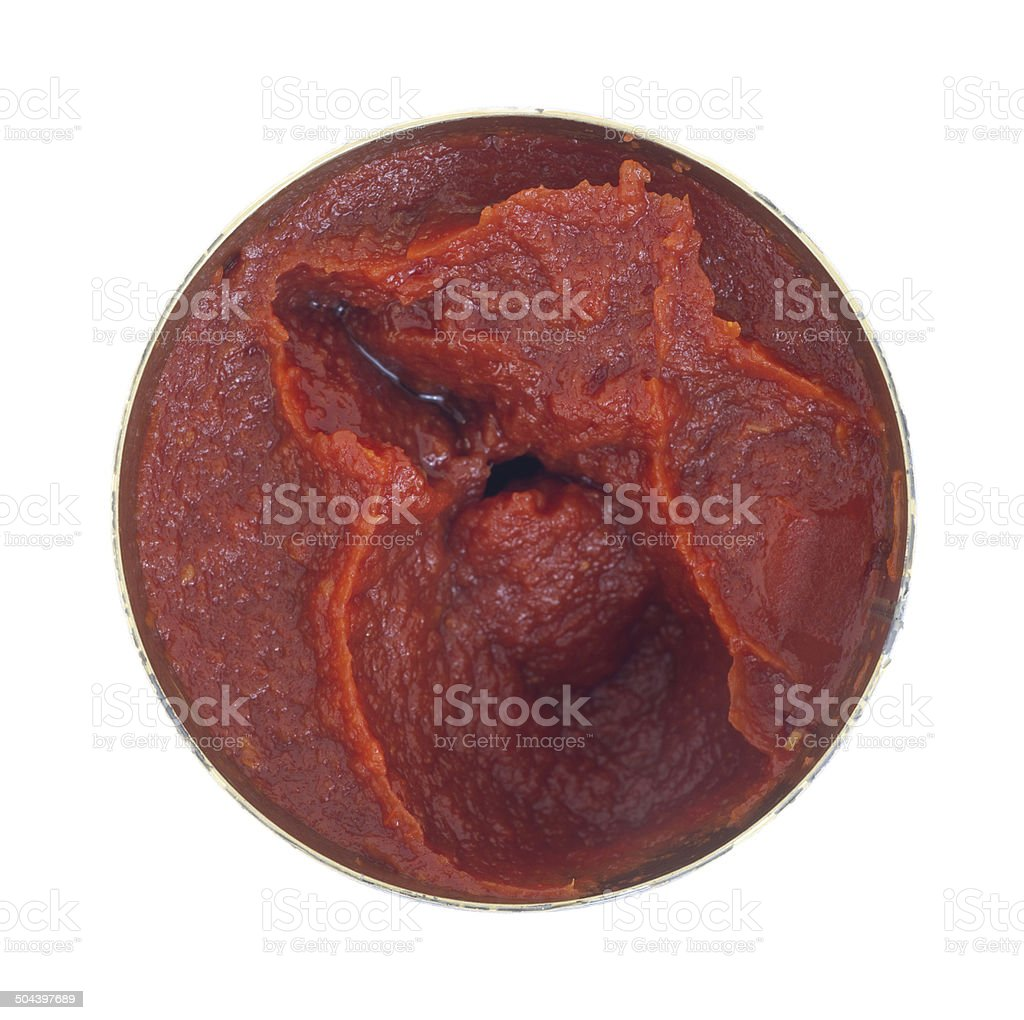 Opened can of tomato paste on a white background stock photo