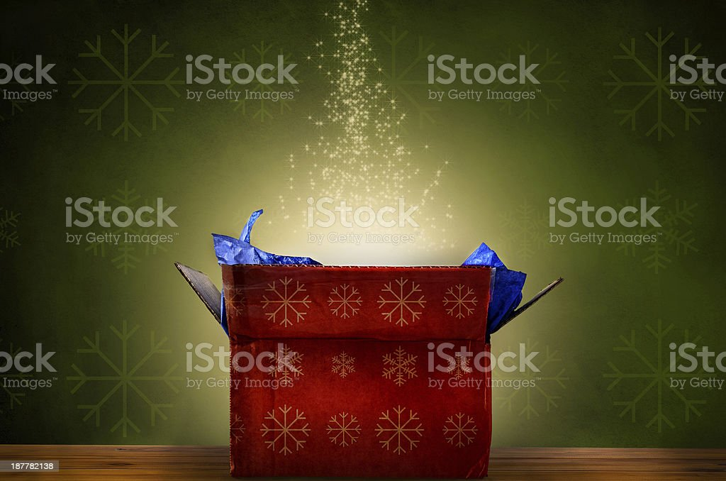 Opened Christmas Gift Box with Glow and Sparkling Stars stock photo
