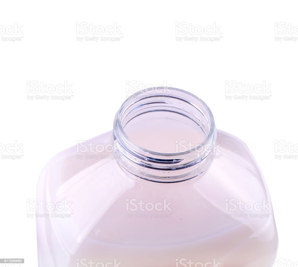 opened clear plastic bottle with a pink liquid stock photo