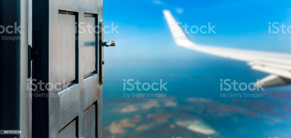 Opened door concept to beautiful and imaginary sky landscape stock photo