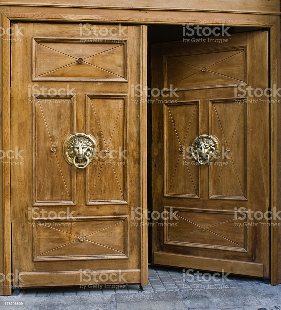 Opened door with ancient style carved knocker royalty-free stock photo