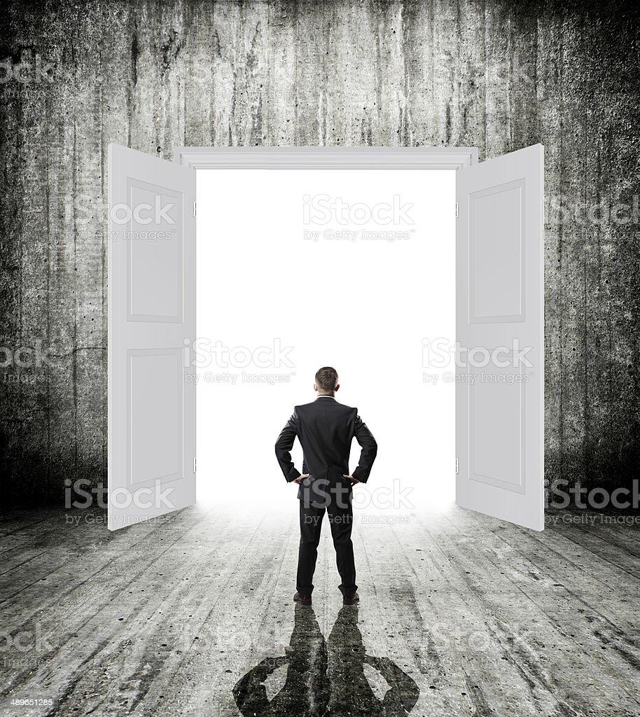 opened door with businessman stock photo