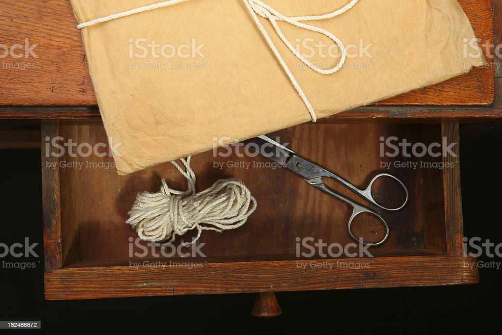 opened drawer with the envelope, scissors and string royalty-free stock photo