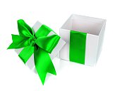 Opened, empty, white Christmas gift box with green bow