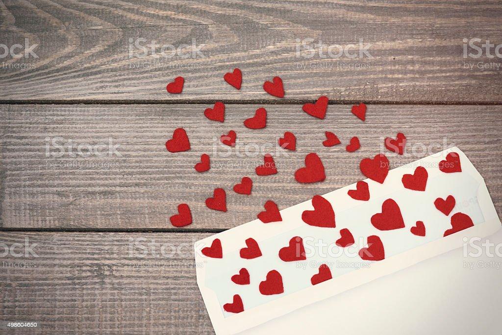 Opened envelope and many felt hearts stock photo