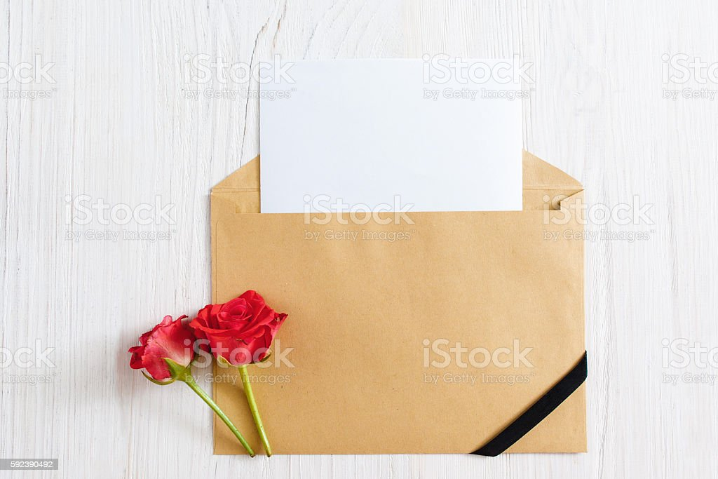 Opened envelope with blank paper and black ribbon stock photo