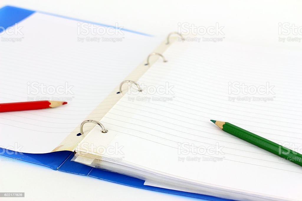 Opened four rings binder with paper end plastic stock photo