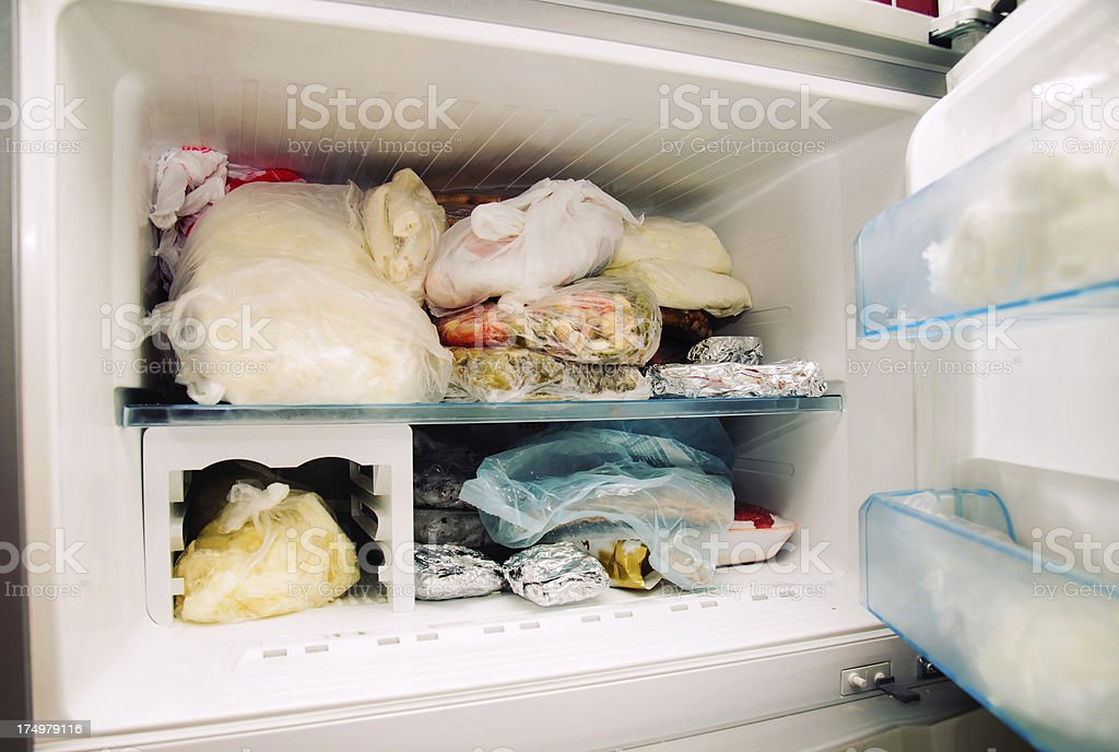 Opened freezer stock photo
