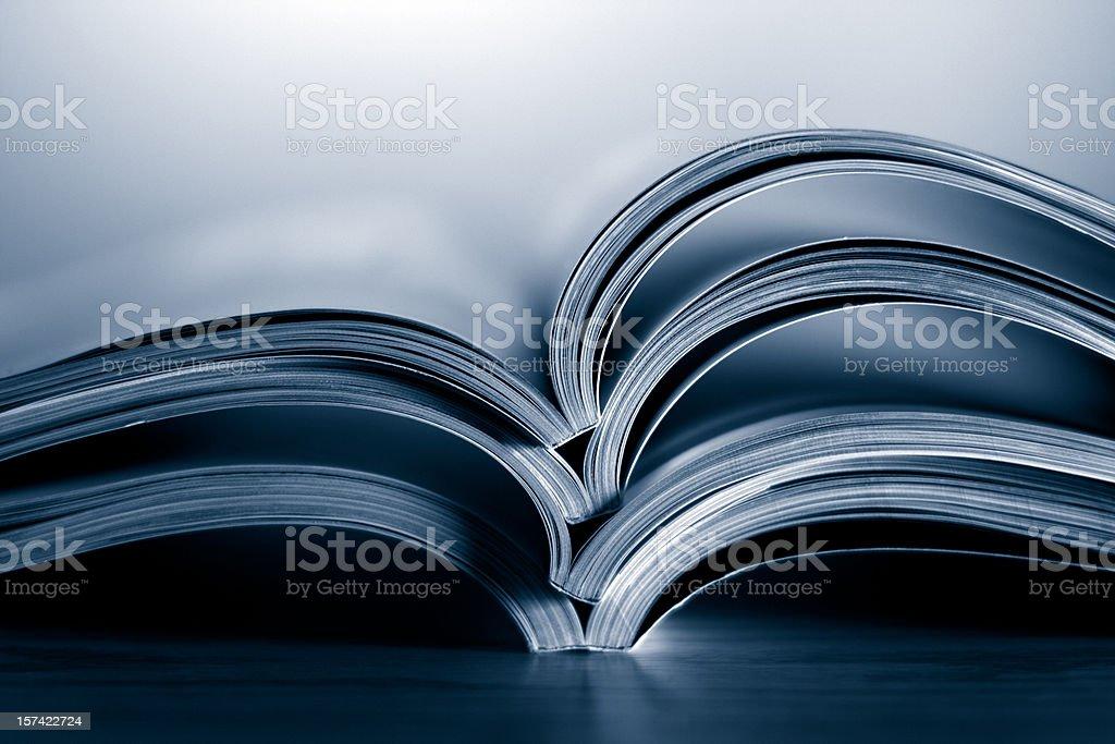 Opened magazines stock photo