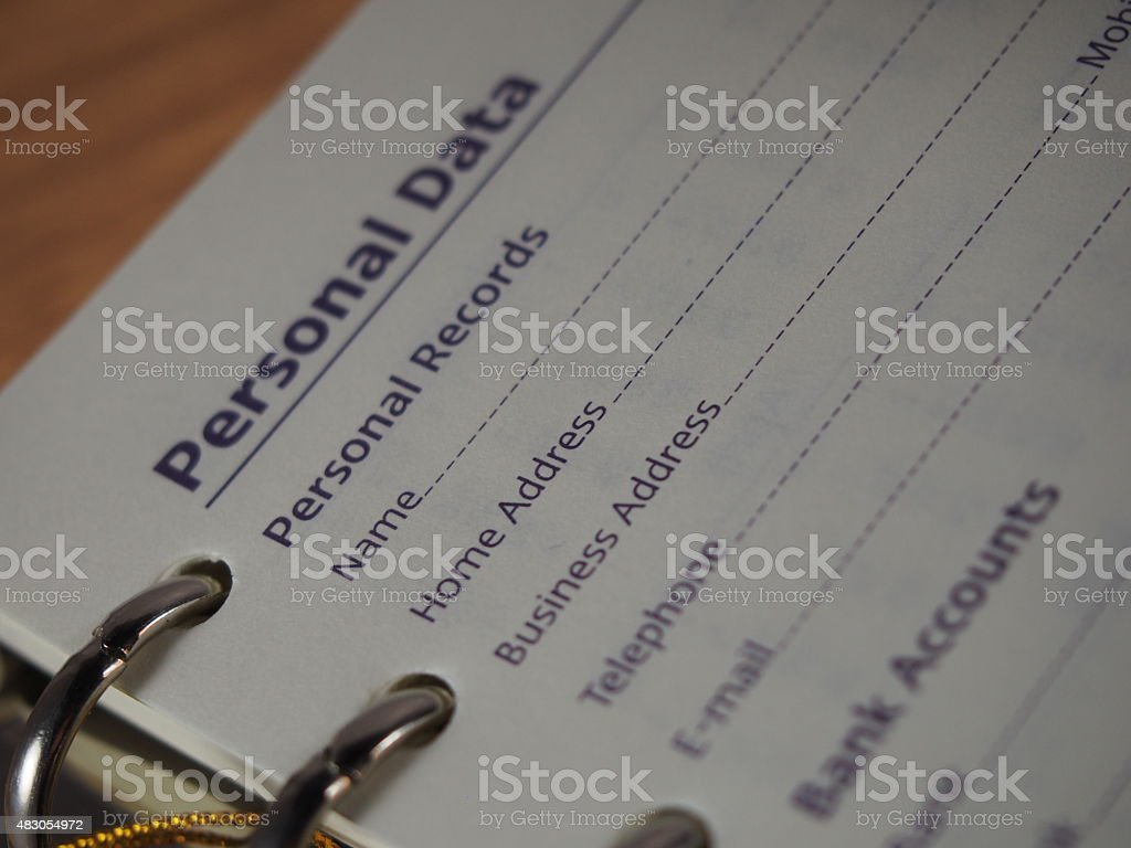 Opened notebook on personal data page stock photo