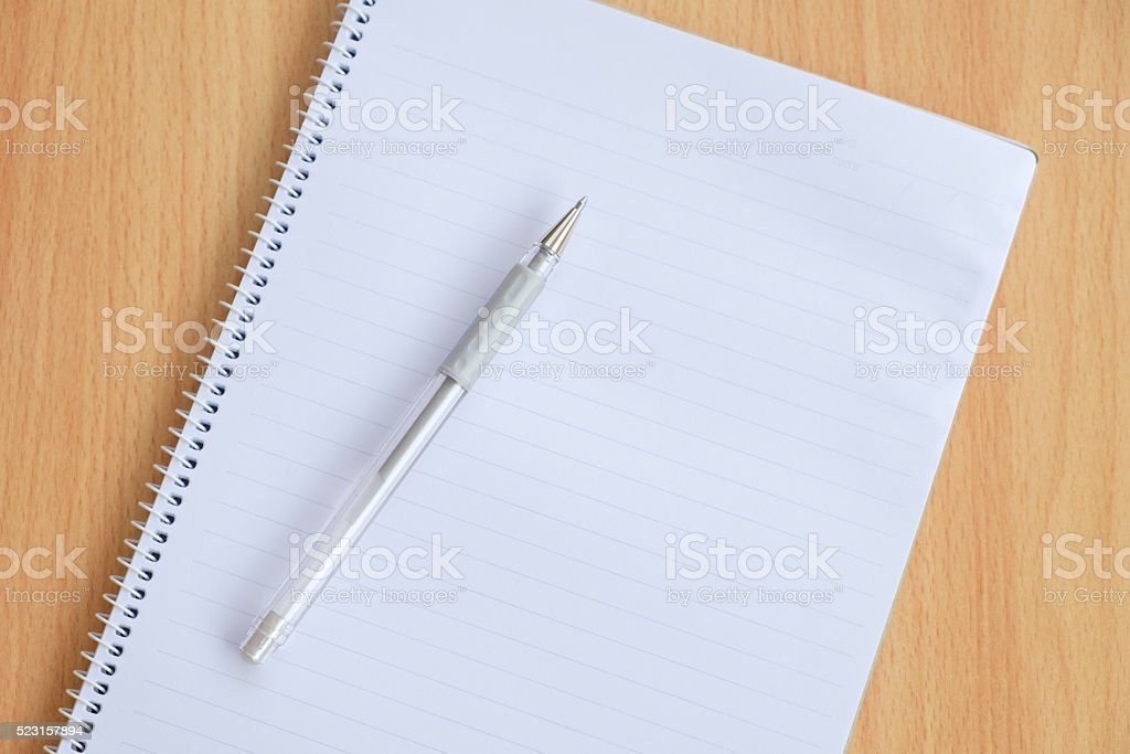 Opened notepad and pen stock photo
