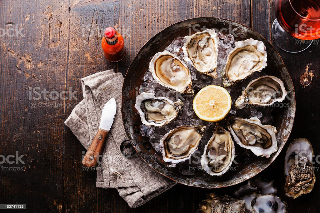 Opened Oysters and rose wine stock photo