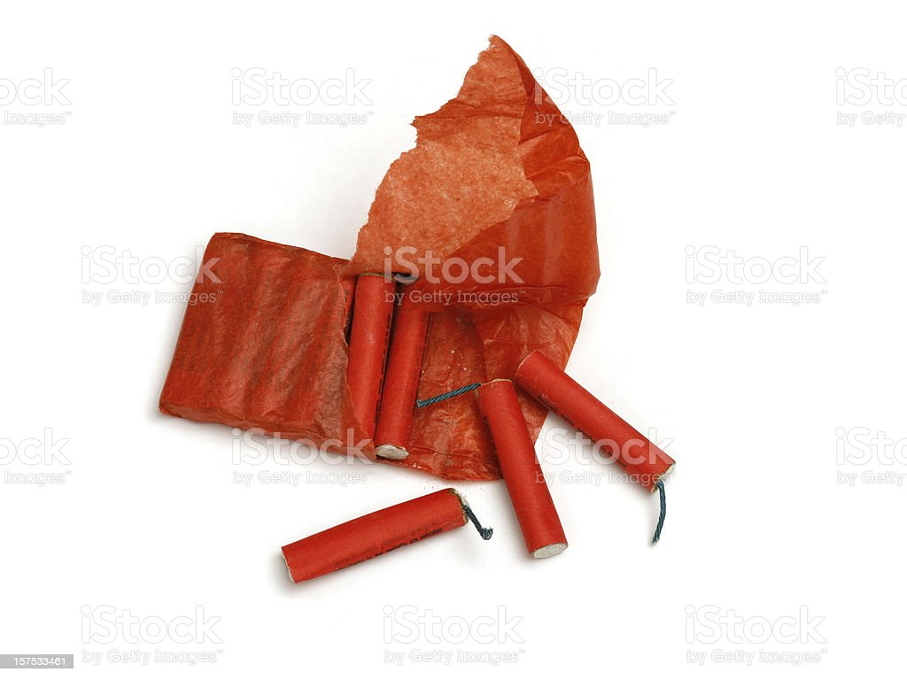 Opened package with red chinese firecrackers, on white background royalty-free stock photo