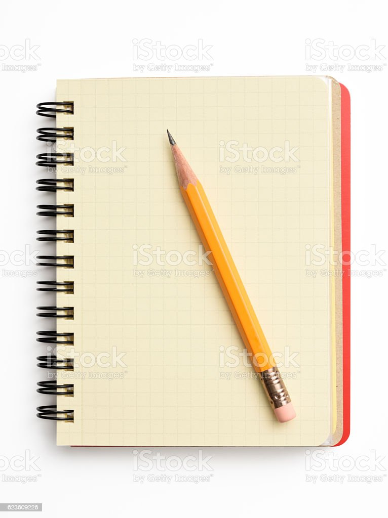 Opened red spiral notebook with yellow pencil on white background stock photo