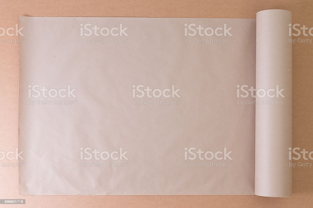 Opened roll of plain brown paper on cardboard stock photo