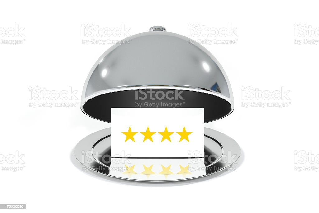 opened silver cloche with white sign four stars rating stock photo