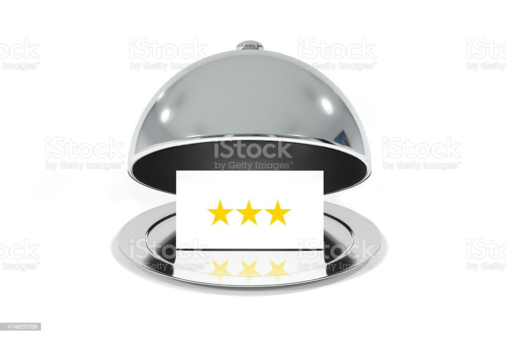 opened silver cloche with white sign three stars rating stock photo