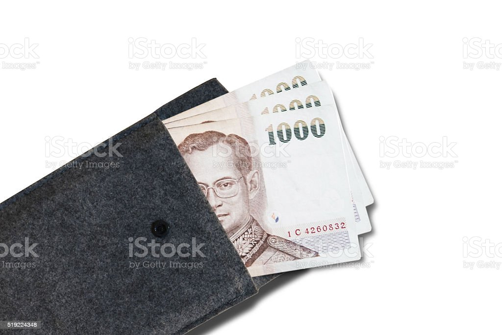 Opened textile purse with Thai 1000 banknote, with copy space stock photo