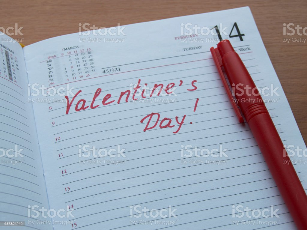 Opened the diary with the words Valentine's Day stock photo