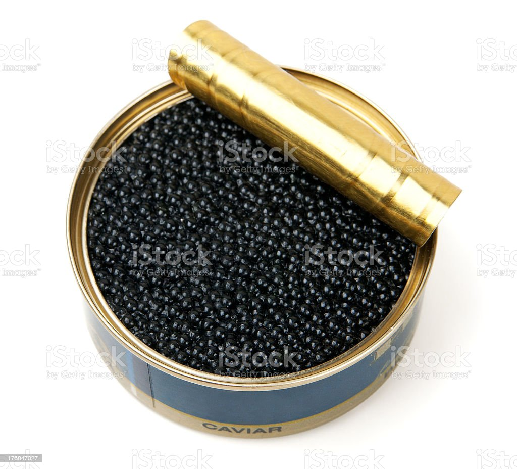 Opened tin of black caviar on a white background stock photo