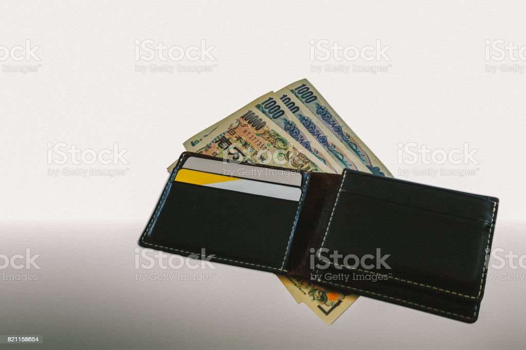 Opened wallet with money yen and credit cards stock photo