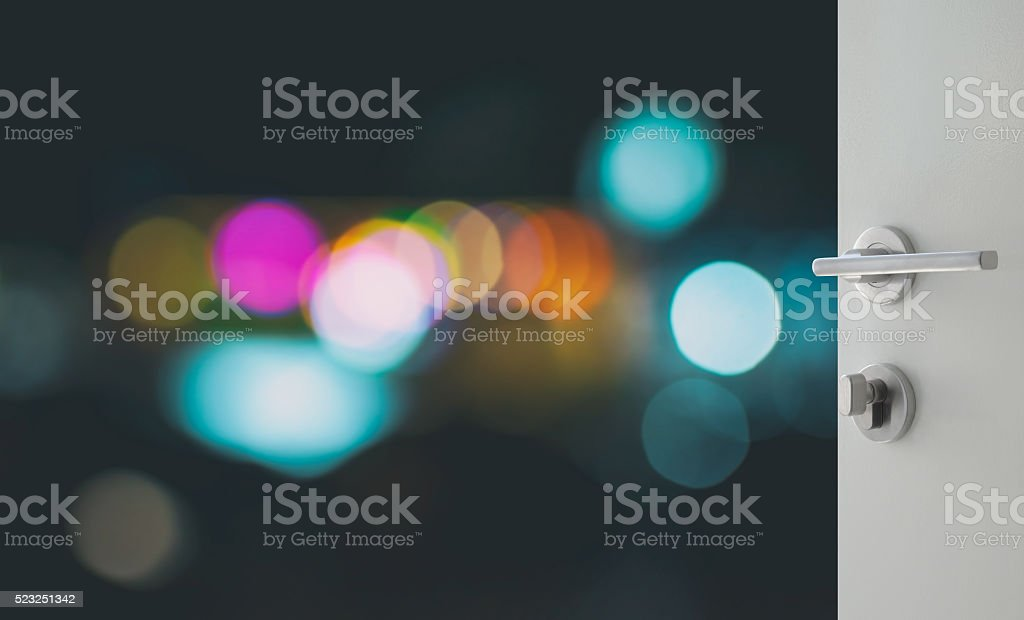 opened white door to abstract background with bokeh stock photo