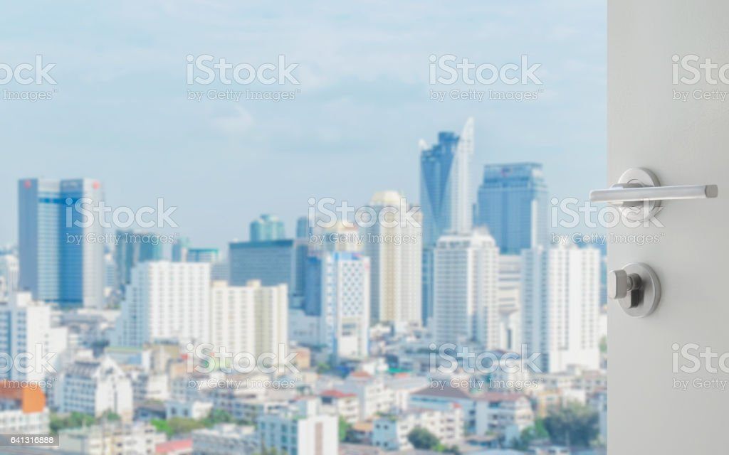 opened white door to bangkok city skyline with modern buidings as background stock photo