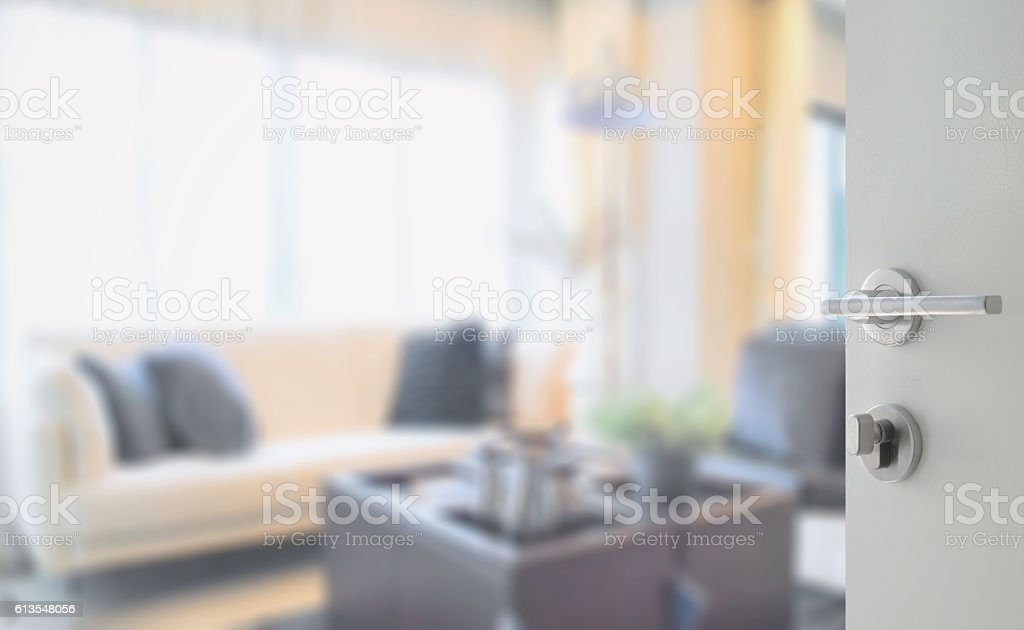 opened white door to modern living room interior stock photo