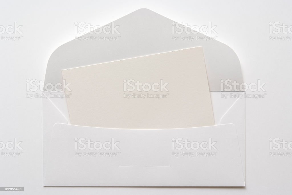 Opened white envelope with blank card on white background stock photo