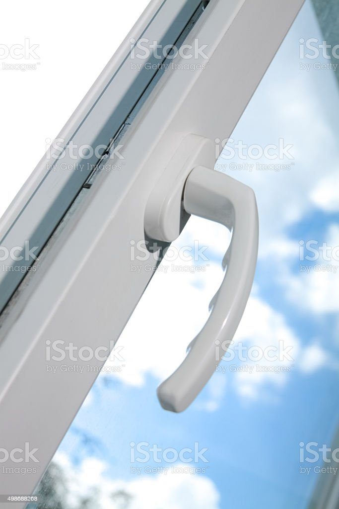 Opened white plastic window  with clouds in background stock photo