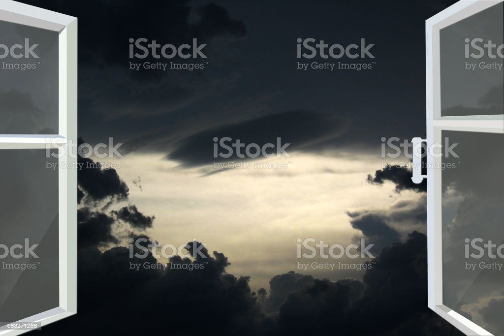 opened window to the dark night heaven with black clouds stock photo