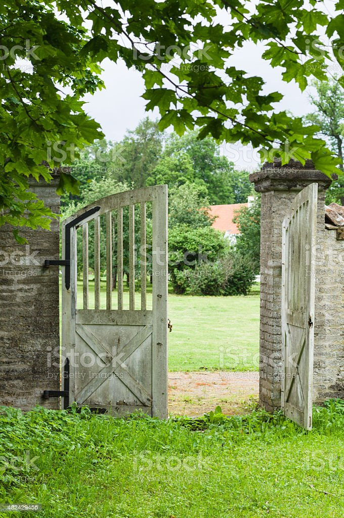 Opened wooden gate in park stock photo