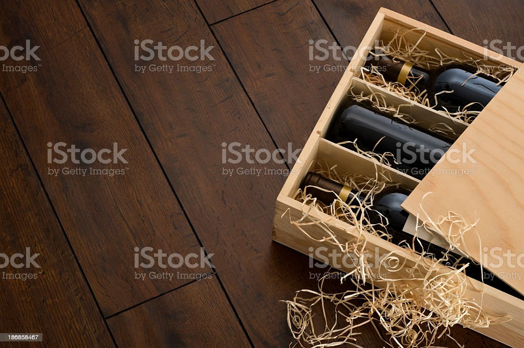 Opened wooden wine box packed with wine and straw stock photo