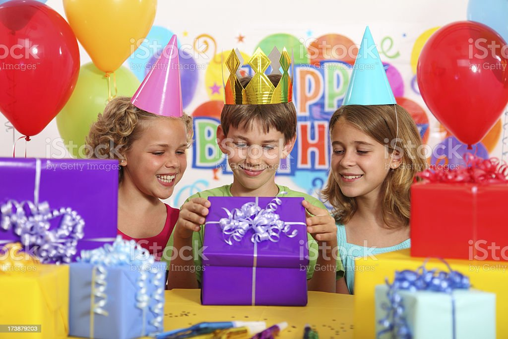Opening A Birthday Present royalty-free stock photo
