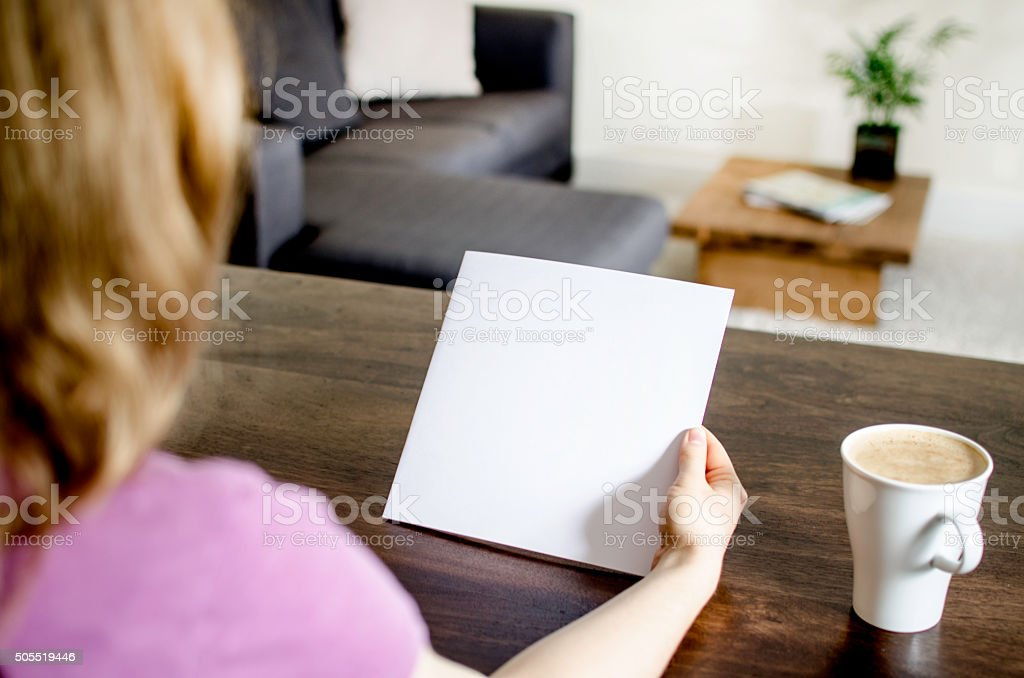 Opening a blank brochure stock photo