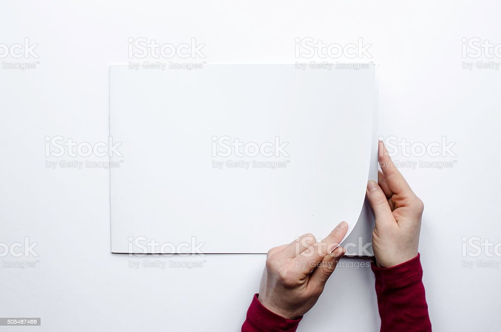 Opening a blank brochure seen from above stock photo