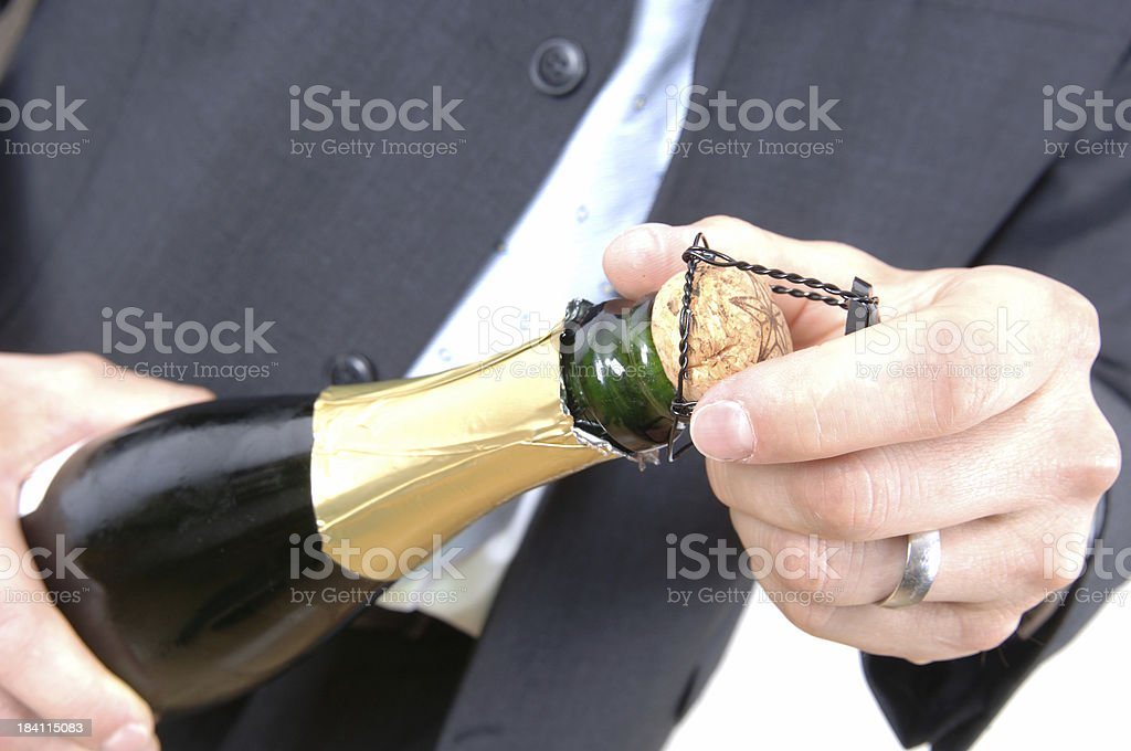 opening a champagne bottle royalty-free stock photo