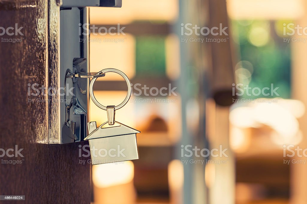 Opening a door with a key. stock photo