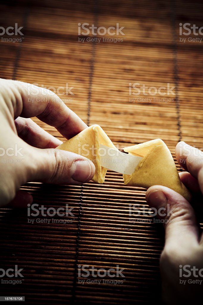 Opening a fortune cookie stock photo