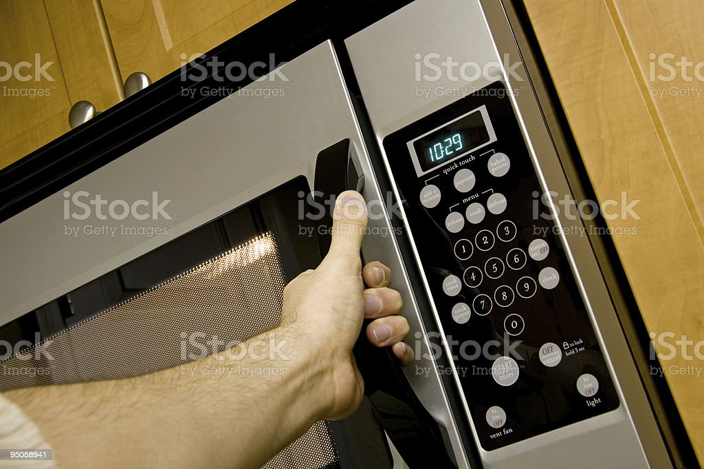 Opening a microwave royalty-free stock photo