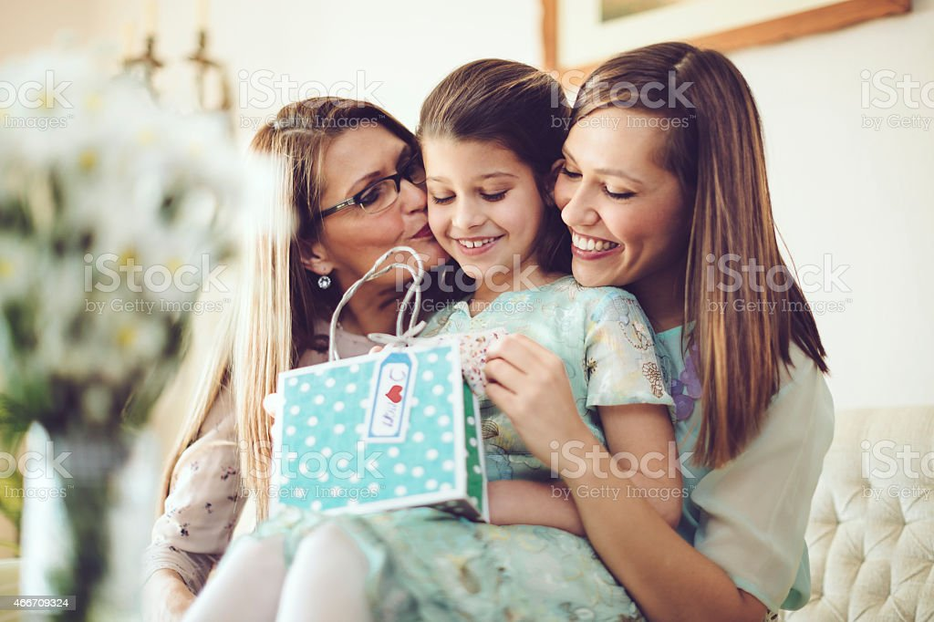 Opening a mother's day present together stock photo
