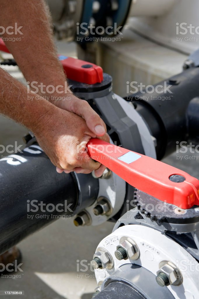 Opening a Pipe royalty-free stock photo