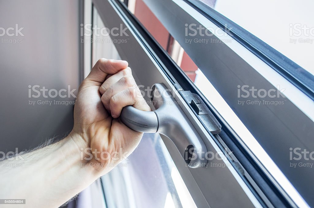 Opening a Window with Hand royalty-free stock photo
