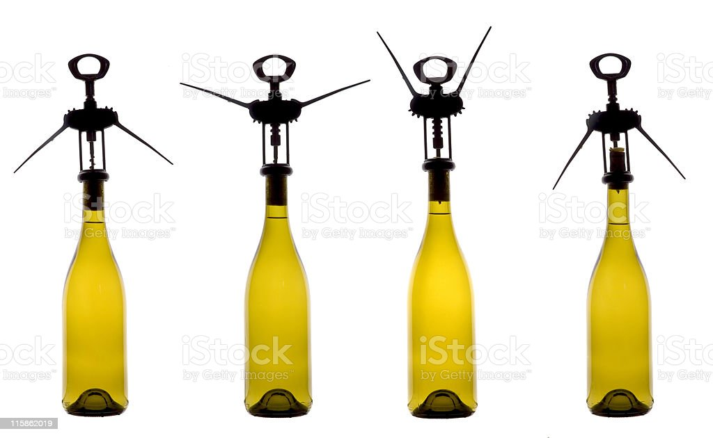 Opening a wine bottle stock photo