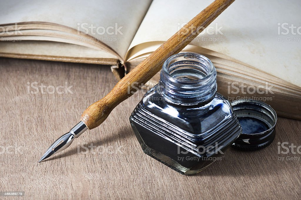 opening books with dip pen stock photo