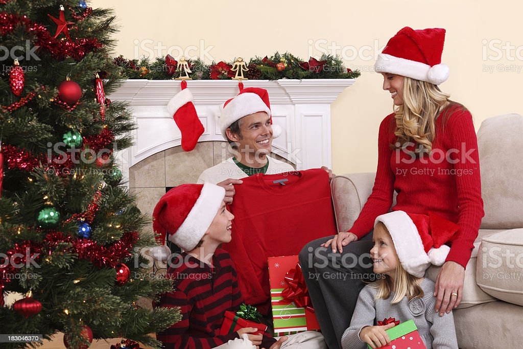 Opening Christmas Gifts royalty-free stock photo