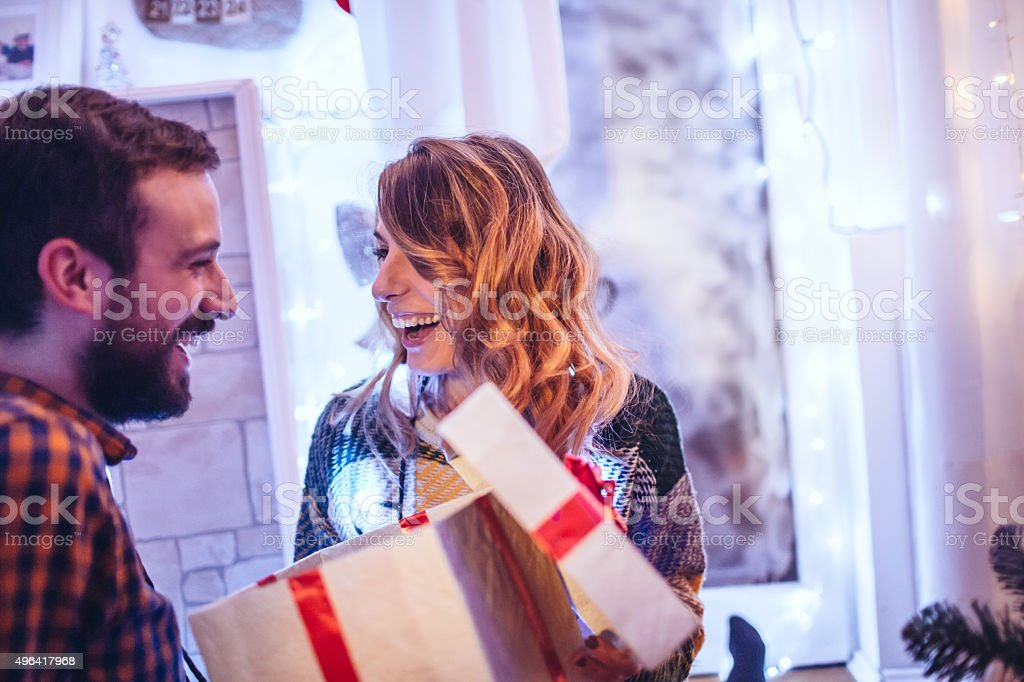 Opening Christmas gifts stock photo